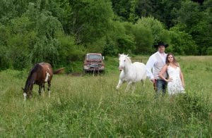 couple with horses and truck
