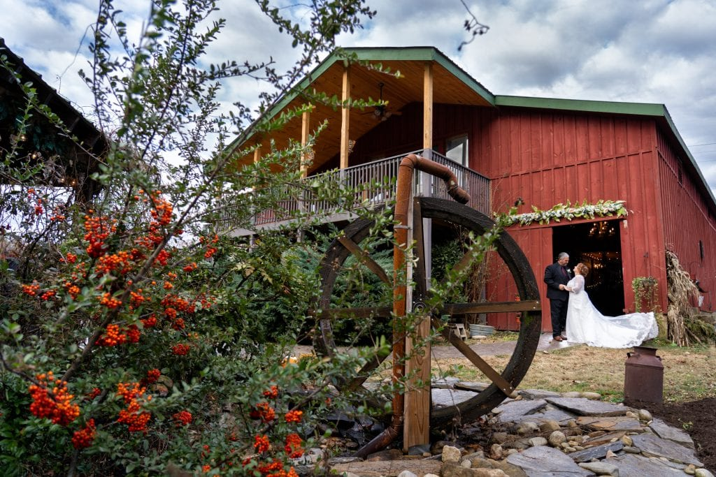 Red wedding barn at Honeysuckle Hills with water wheel