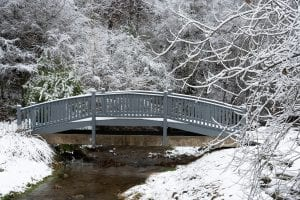 Arched Bridge in the snow at Honeysuckle Hills